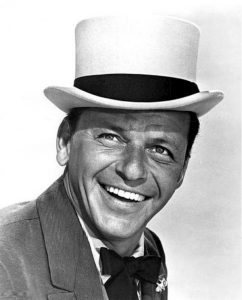Black and white portrait of Frank Sinatra in a white hat