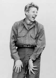 Black and white still of Danny Kaye laughing