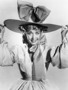 Black and white portrait of Jane Powell in an oversized hat
