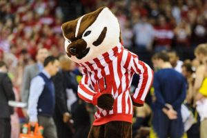 Bucky Badger dancing on the court at the men's basketball game