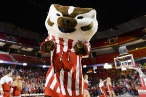 Bucky Badger pointing to the crowd at a men's basketball game